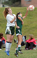 Lansdale Catholic's  Colbie Cummings (left) heads the ball away from Methacton's  Lexi Laconi (right) in the first half of a soccer game at Lansdale Catholic High School Tuesday September 22, 2015 in Lansdale, Pennsylvania.  (Photo By William Thomas Cain)