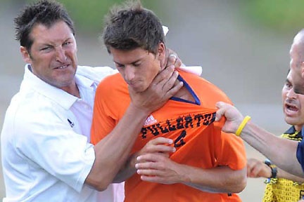 Cal State Fullerton soccer coach Bob Ammann, left, uses a choke hold to remove player Deniz Sevino from the field during a tournament game at Titan Stadium on September 5, 2008. Cal State Fullerton lost to UNLV 1-0. Photo by Jann Hendry