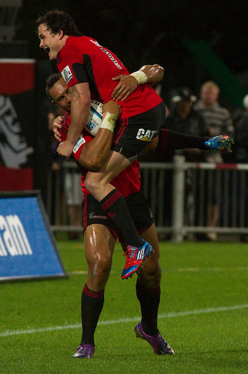 Zac Guildford celebrates with Robbie Fruean after he scored a try at the Investec Super Rugby, Chiefs vs Crusaders game, McLean Park Stadium, Napier, New Zealand. Photo: SNPA / Bethelle McFedries