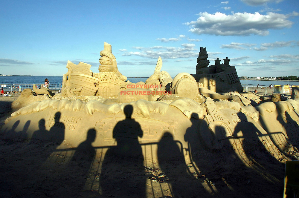 """Sand and Shadows"" The annual Revere Beach Sand Sculptue Festival is the venue as the art frames shadows of the throngs that came at sunset to check out the artwork."