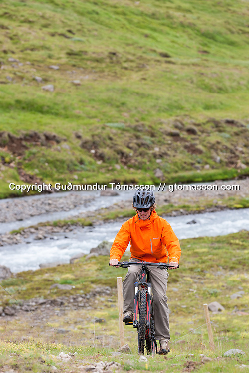 Jökull Bergmann mountain biking at Klængshóll, Skíðadalur, North, Iceland.