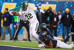 Dec 3, 2016; Morgantown, WV, USA; Baylor Bears running back Terence Williams (22) runs for a touchdown during the second quarter against the West Virginia Mountaineers at Milan Puskar Stadium. Mandatory Credit: Ben Queen-USA TODAY Sports