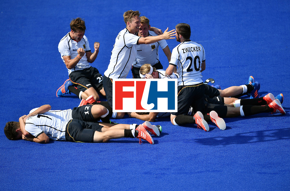 Germany's players celebrate after winning the men's Bronze medal field hockey Netherlands vs Germany match of the Rio 2016 Olympics Games at the Olympic Hockey Centre in Rio de Janeiro on August 18, 2016. / AFP / MANAN VATSYAYANA        (Photo credit should read MANAN VATSYAYANA/AFP/Getty Images)