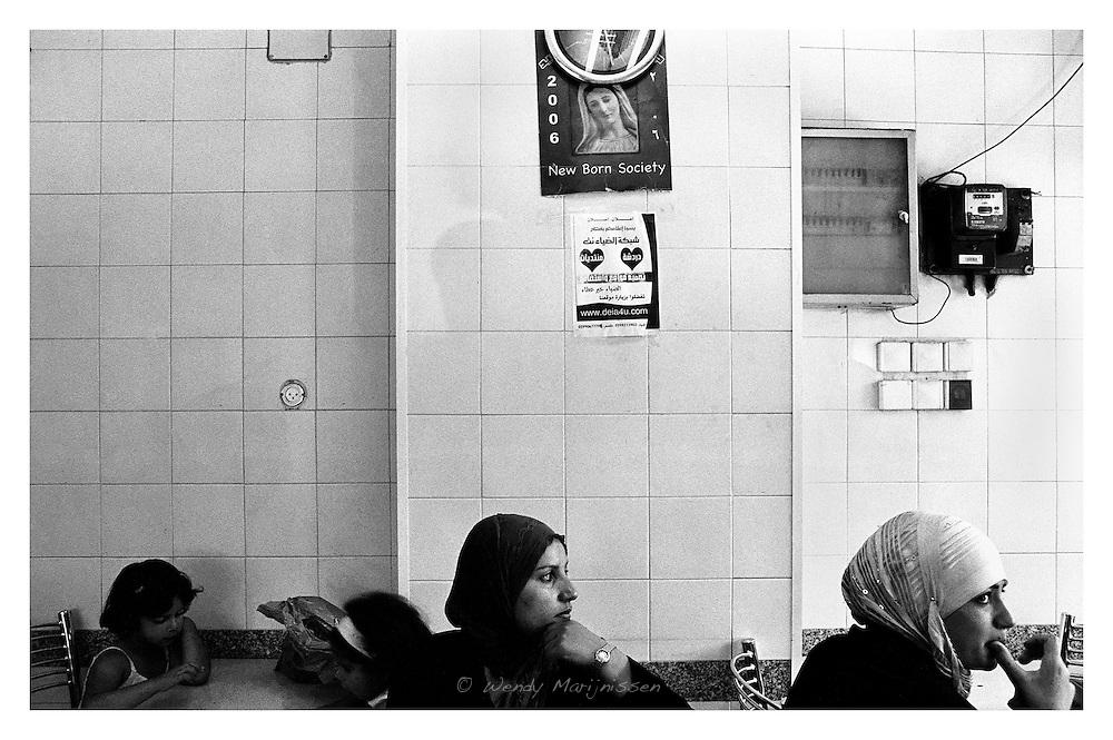 Young Palestinian women and their children in a local restaurant. Bethlehem, Palestine, 2007