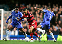 Photo: Tom Dulat.<br /> <br /> Chelsea v Queens Park Rangers. FA Cup Third Round. 05/01/2008. <br /> <br /> Dexter Blackstock of Queens Park Rangers in between Mikel (L) and Ashley Cole (R) of Chelsea.