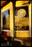 Old clock & picture window at the DDD Deli catch late afternoon sunlight in Kirkwood. Missouri