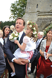 DAVID CAMERON and his daughter NANCY CAMERON at the wedding of Lohralee Stutz and the Hon.William Astor at St.Augustine's Church, East Hendred, Oxfordshire on 5th September 2009.