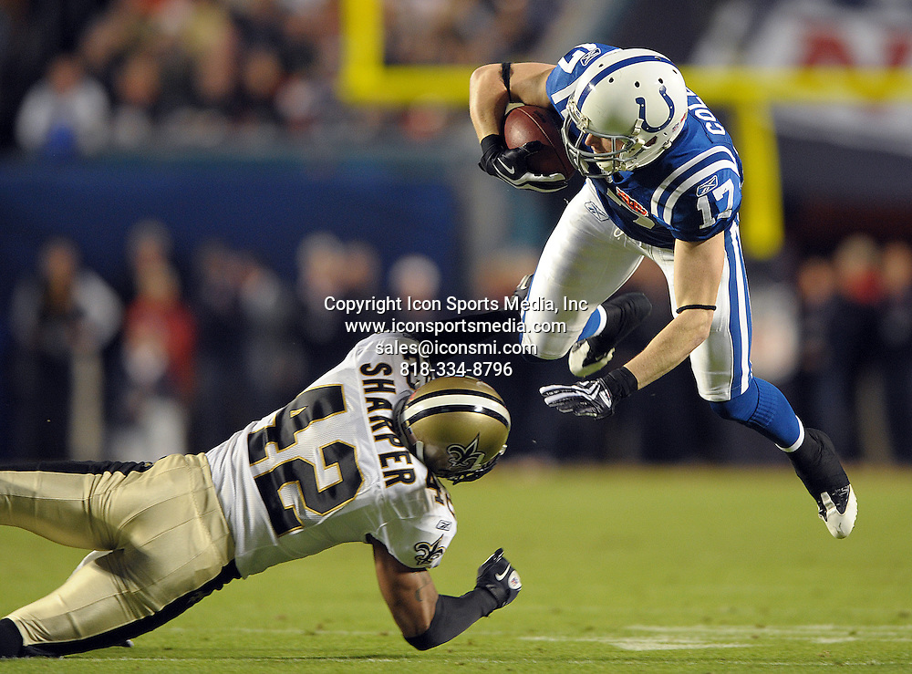 Feb. 07, 2010 - Miami Gardens, FL - Florida, USA - United States - --   Indianapolis Colts receiver Austin Collie is tripped up by New Orleans Saints Darren Sharper during the 1st quarter of Super Bowl XLIV at Sun Life Stadium.