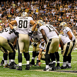 September 23, 2012; New Orleans, LA, USA; New Orleans Saints quarterback Drew Brees (9) talks with his team in the offensive huddle during overtime of a game against the Kansas City Chiefs at the Mercedes-Benz Superdome. The Chiefs defeated the Saints 27-24 in overtime. Mandatory Credit: Derick E. Hingle-US PRESSWIRE