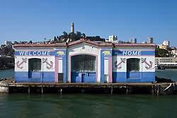 "The edge of Pier 31 reads ""Welcome Home"", San Francisco, California."