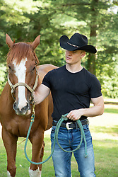 handsome cowboy with a horse