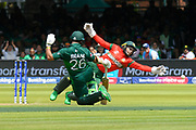Mushfiqur Rahim (wk) of Bangladesh dives and misses as he tries and stop the ball going for four runs as it is thrown at the stumps by Mehedi Hasan of Bangladesh in an attempt to run out Imam-ul-Haq of Pakistan during the ICC Cricket World Cup 2019 match between Pakistan and Bangladesh at Lord's Cricket Ground, St John's Wood, United Kingdom on 5 July 2019.