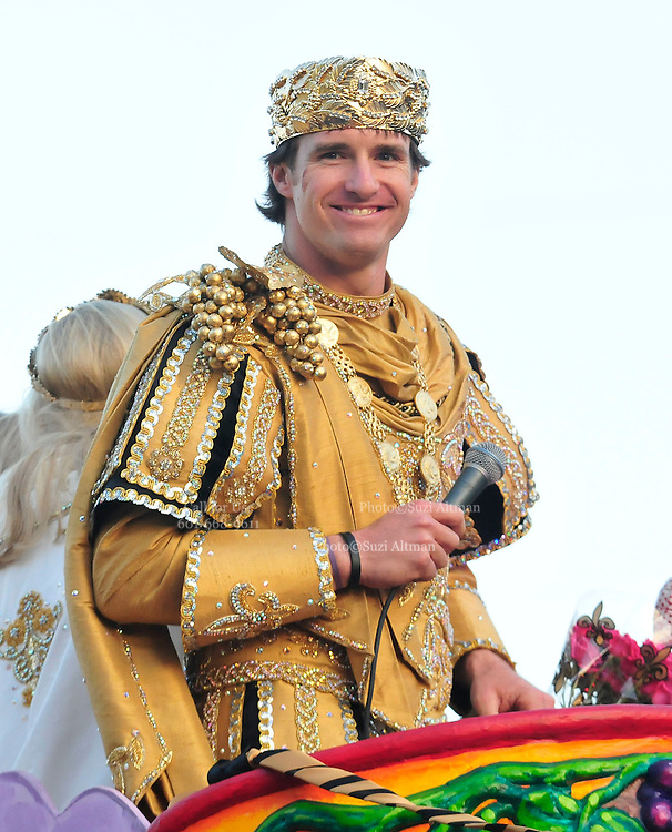King of Bacchus Mardi Gras parade and King of the World after winning the Super Bowl QB Drew Brees grabs the reigns of the Bacchus chariot and starts the parade.Escorted by extra security to thte float Super Bowl Champ and Bacchs King Drew Brees. New Orleans Saints QB and Super Bowl Champion Drew Brees is the King of Bacchus and King of the World as he breeses past Tipatinas and leads the Bacchus Parade with his wife on Valentines Day in New Orleans to a throng of happy fans Feb 14, 2010. Brees concentrates as he throws balck and gold footballs to the mass of fans.Photo  Suzi Altman/SuziSnaps