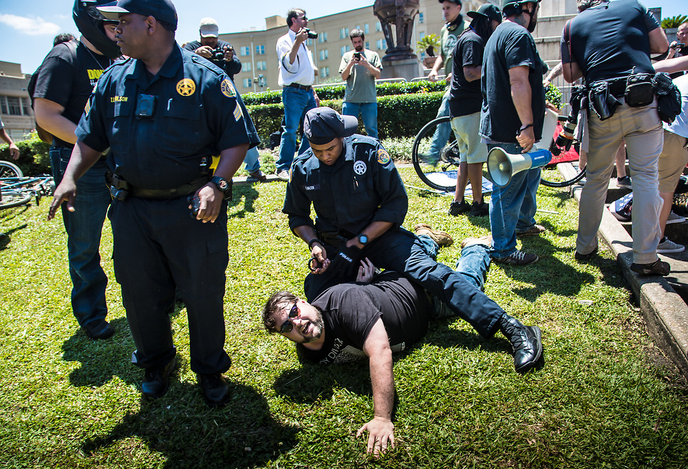 Matt Setzten, New Orleans residnet and former LA National Guard being arrested after trying to defend a man who was about to be stabbed with a flag pole.