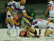 Players Tackled in the snow at Wakefield Trinity vs Widnes Vikings during the Betfred Super League match at Mobile Rocket Stadium, Belle Vue, Wakefield<br /> Picture by Stephen Gaunt/Focus Images Ltd +447904 833202<br /> 17/03/2018