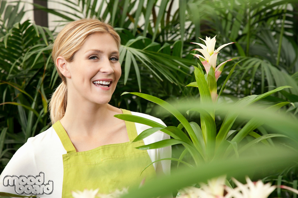 Portrait of a cheerful young woman in garden
