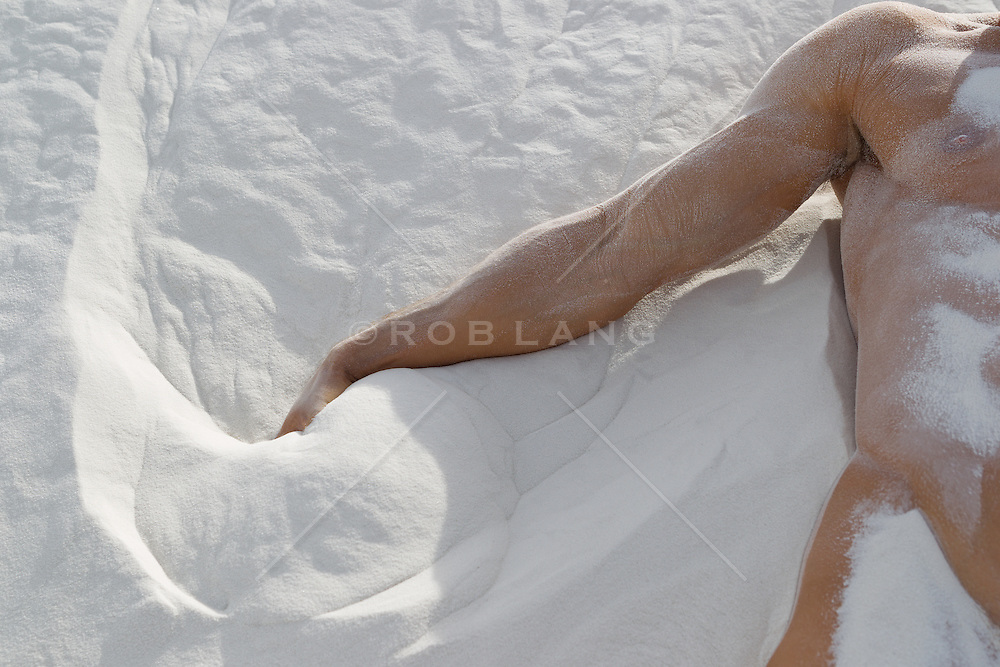 detail of a sexy man in White Sands, NM