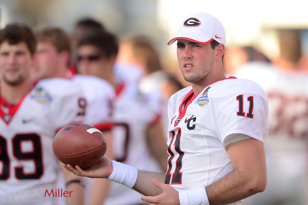 Georgia Bulldogs quarterback Aaron Murray (11) on the sidelines during the Bulldogs 45-31 win over the Nebraska Cornhuskers in the Capital One Bowl at the Florida Citrus Bowl on Jan 1, 2013 in Orlando, Florida. ..©2012 Scott A. Miller..