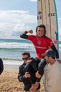 Edouard Delpero, carried aloft by supporters as he is crowned Men's Longboard Pro Champion, Boardmasters 2019 at Fistral Beach, Newquay, Cornwall, United Kingdom on 11 August 2019.