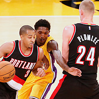 11 October 2016: Portland Trail Blazers guard C.J. McCollum (3) drives past Los Angeles Lakers guard Louis Williams (23) on a screen set by Portland Trail Blazers forward Mason Plumlee (24) during the Portland Trail Blazers 109-106 OT victory over the Los Angeles Lakers, at the Staples Center, Los Angeles, California, USA.