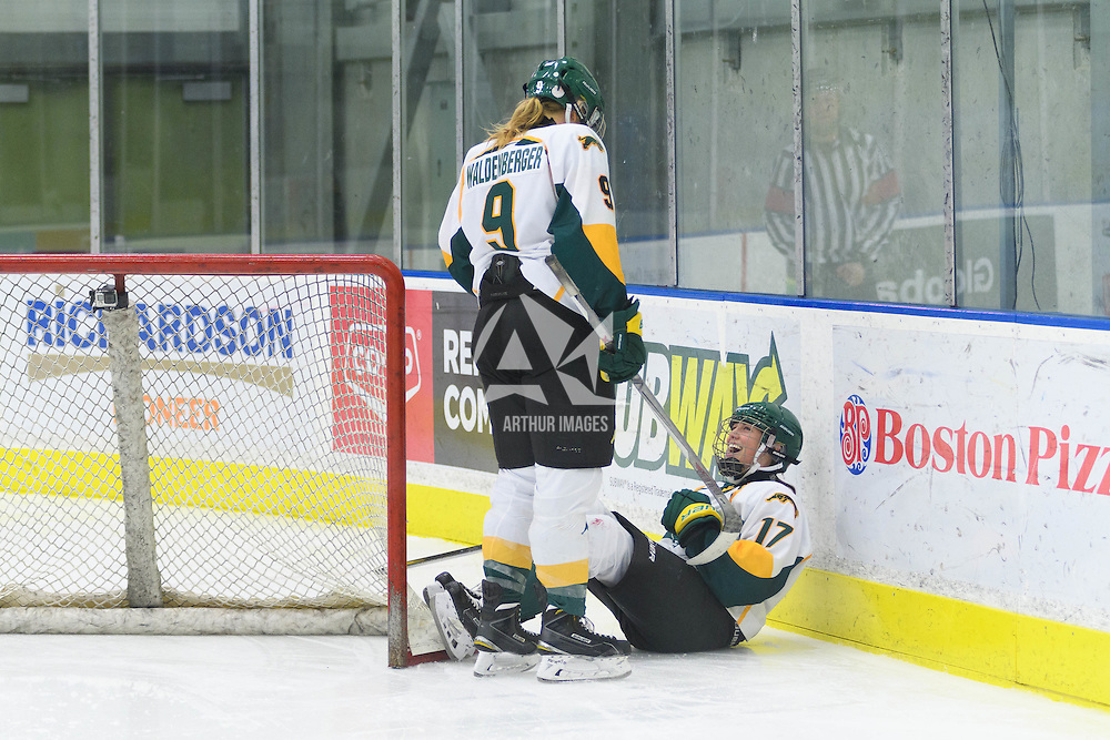3rd year forward Emma Waldenberger (9) and 1st year forward Lilla Carpenter-Boesch (17) of the Regina Cougars of the Regina Cougars in action during the Women's Hockey Home Game on October 15 at Co-operators arena. Credit: Arthur Ward/Arthur Images