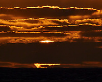 Sun setting over the Pacific Ocean from the deck of the MV World Odyssey. Semester at Sea, 2016 Spring Semester Voyage. Day 2 of 102. Image taken with a Nikon 1 V3 camera and 70-300 mm VR lens (ISO 200, 300 mm, f/16, 1/400 sec).
