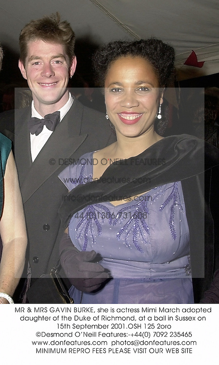 MR & MRS GAVIN BURKE, she is actress Mimi March adopted daughter of the Duke of Richmond, at a ball in Sussex on 15th September 2001.OSH 125 2oro