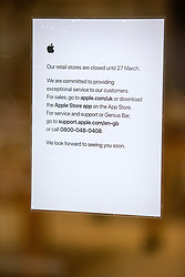 © Licensed to London News Pictures. 15/03/2020. LONDON, UK.  Apple store employees put up notices informing customers that the shop on Regent Street will be closed until the 27 March. The company is closing all its retail outlets outside of China for the next two weeks due to the spread of Coronavirus .  Photo credit: Cliff/LNP