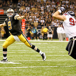September 25, 2011; New Orleans, LA, USA; New Orleans Saints quarterback Drew Brees (9) throws a touchdown under pressure by Houston Texans linebacker Connor Barwin (98) during the third quarter at the Louisiana Superdome. The Saints defeated the Texans 40-33. Mandatory Credit: Derick E. Hingle