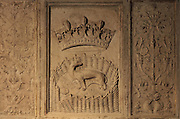 Ermine with a crown, representing Anne of Brittany, and candelabra, relief on a fireplace in the Lower Room of the Hotel Lallemant, a mansion built 1495-1518 in French Renaissance style by the Lallemant merchant family, in Bourges, Centre Val de Loire, France. The fireplace is carved with coats of arms and also royal emblems representing Louis XII (porcupine) and Anne of Brittany, who both visited Bourges in 1506. The sculptural decoration on the building, made by both French and Italian sculptors, has been interpreted by Fulcanelli and others as having an alchemical symbolism. Since 1951 the building has housed the Musee des Arts Decoratifs and it was listed as a historic monument in 1840. Picture by Manuel Cohen