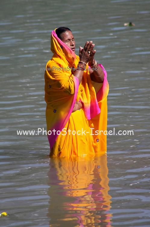 India, Uttarakhand, Rishikesh, Pilgrims bathe in the Ganges River