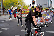 04/25/12-  Andy DeLisle.Phoenix police clear the way for protestors in the March for Justice against SB 1070 on Wednesday April, 25 2012 in Phoenix, AZ.