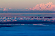 Early morning shot of the Fire Island in the fog of Cook Inlet and Anchorages closest volcano  Mount Spurr in the background.