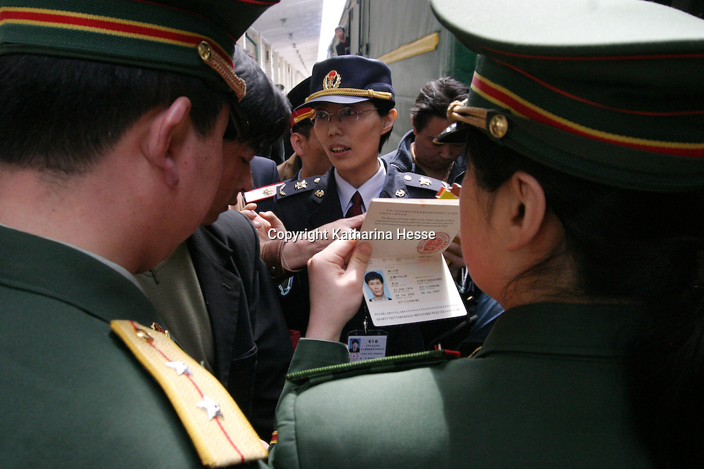 NORTHERN CHINA-APRIL 25:  A North Korean soldier checks a passenger's passport before the passenger could board a train April 25, 2004 bound for Pyongyang in Dandong, Liaoning province, China. At least 154 people died, 76 of whom are confirmed children and more than 1300 were injured in a train explosion in Ryonchon, a North Korean town 20 km across the Dandong border. China said on Saturday it would give North Korea $1.21 million worth of medical supplies, tents, and food to help it cope with the train disaster in Ryongchon.