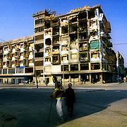 Kuito, Angola                                       September, 2002<br /> <br /> The tallest building  in Kuito, Angola, an apartment block, was destroyed during the 27-year civil war. The building, however, has remained inhabited despite the dangerous conditions of the structure.  Photo by Lori Waselchuk/South Photographs