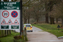 © Licensed to London News Pictures. 09/02/2020. London, UK. Police patrol the park ad Drivers and runners are turned away at Richmond Gate in Richmond Park as it closes its gates to the public. Storm Ciara hits London and the South East as Richmond Park and 7 other Royal Parks close their gates this morning as weather experts predict stormy weather with very high winds and heavy rain for Sunday. Photo credit: Alex Lentati/LNP