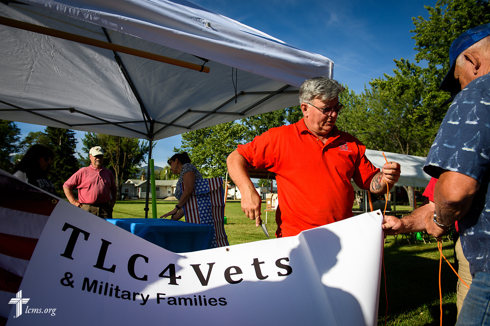 Paul Turpin, a veteran and church member at Trinity Lutheran Church, Grangeville, Idaho, works with fellow volunteers to erect the TLC4Vets outreach tent at the Grangeville Border Days Independence Day celebration and parade on Tuesday, July 4, 2017, in Grangeville. LCMS Communications/Erik M. Lunsford