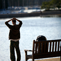 Young man by the sea, Conleau island, town of Vannes, departament of Morbihan, region of Brittany, France