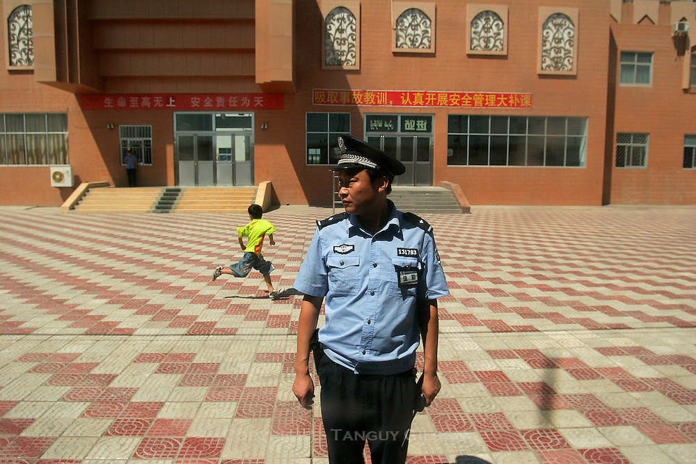 Chinese police officer at train station in china