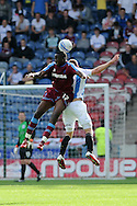 Picture by Graham Crowther/Focus Images Ltd. 07763140036.10/9/11  .Calum Woods of Huddersfield is outjumped by Lucas Akins of Tranmere during the Npower League 1 game at the Galpharm Stadium, Huddersfield.