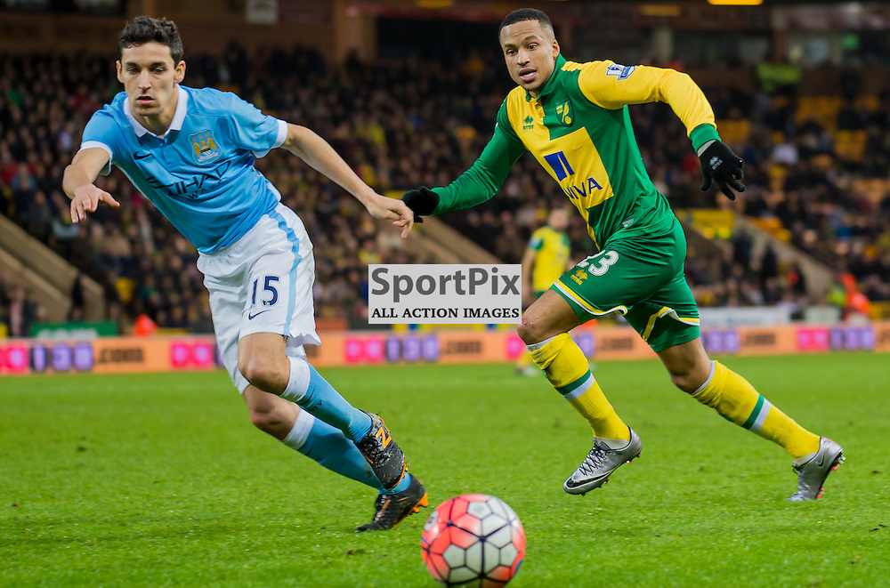 Manchester City midfielder Jesus Navas (15) and Norwich City defender Martin Olsson (23) chase a loose ball
