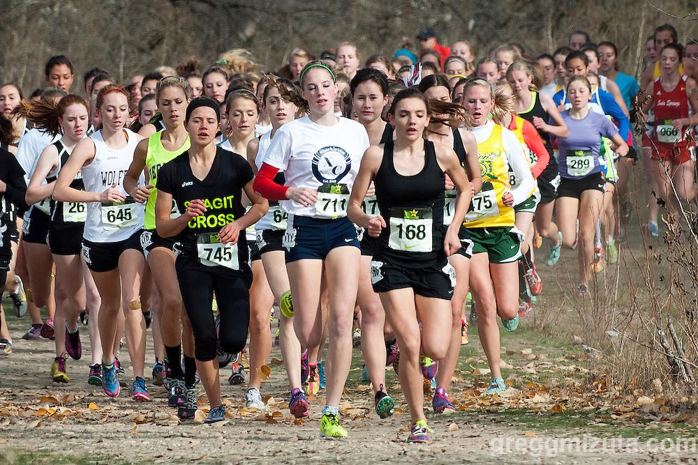Eventual winner Mikala Malaspina takes the early lead in the girls varsity race (L to R: 645 Devon Bortfeld, 745 Rayn Joy Norton, 711 Sam McKinnon, 168 Mikayla Malaspina, 170 Cheryn Trapp, 171 Kira Tristan, 475 Sarah Christianson) during the NXN Northwest Championships on November 10, 2012 at Eagle Island State Park in Boise, Idaho...Top finishers: 1st sophomore Mikayla Malaspina (18:49.8).  2nd freshman Sarah Christianson  (19:15.6), 3rd junior Elise Tello (19:22.0), 4th junior Rayn Joy Norton (19:23.8), 5th junior Sarah Medved (19:26.5), 6th senior Tori Klein (19:42.9), 7th junior Anastasia Kosykh (19:45.0), 8th senior Cheryn Trapp (19:48.80).