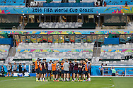England manager Roy Hodgson (C) talks to his team during the England training session the day before their final Group D match against Costa Rica at Mineirão, Belo Horizonte, Brazil. <br /> Picture by Andrew Tobin/Focus Images Ltd +44 7710 761829<br /> 23/06/2014