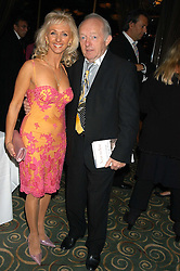 Magician PAUL DANIELS and his wife DEBBIE McGEE at a party to celebrate the publication of 'Next To You' - Caron's Courage remembered by her mother Gloria Hunniford held on Caron's birthday at The Hilton Park Lane, London on 5th Octobe 2005.<br />