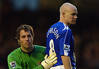 Photo: Paul Greenwood.<br />Everton v Aston Villa. The Barclays Premiership. 11/11/2006. Villa goalkeeper Thomas Sorensen consoles Everton striker Andy Johnson.