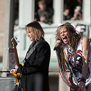 05 November 2012:  Aerosmith's Steven Tyler and bass player Tom Hamilton perform a free concert in Boston's Allston neighborhood in front of the apartment building, 1325 Commonwealth Ave, which was the band's home in the early 1970's.  Boston, MA. ***Editorial Use Only*****