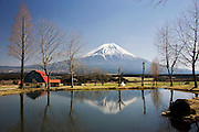 Mt Fuji forms the backdrop to a campsite near Fumoto along a walk that takes trekkers through parts of the Asagiri Plateau in Shizuoka Prefecture Japan on 22 March 2013.  Photographer: Robert Gilhooly