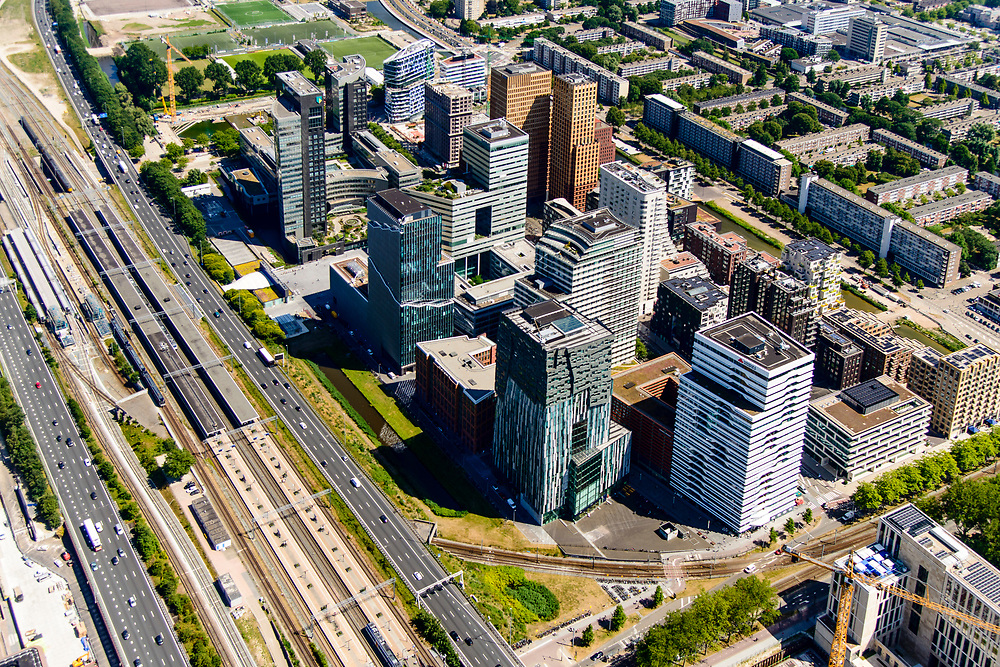 Nederland, Noord-Holland, Amsterdam-Zuid, 29-06-2018; Overzicht Zuid-as en Station-Zuid en lokatie toekomstig Zuidasdok. Buitenveldert in de achtergrond.<br /> Overview 'South-axis', financial district<br /> luchtfoto (toeslag op standard tarieven);<br /> aerial photo (additional fee required);<br /> copyright foto/photo Siebe Swart