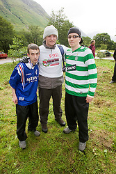 John with workmates Thomas Kelly, 28, and Paul Rooney, 18, from Alba Picture Framing and Sports Memorabilia in Coatbridge, exchanged their Old Firm tops at the peak..The John Hartson Foudation walk up Ben Nevis..Pic ©2010 Michael Schofield. All Rights Reserved.