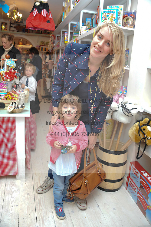 LAURA LOPES and her daughter ELIZA at the opening of the new HoneyJam children's store at 2 Blenheim Crescent, London W11 on 7th July 2011.